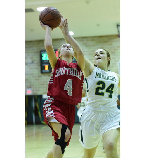 Southold sophomore Madison Tabor goes up for a shot as Mercy's Nicole Gravagna guards. (Credit: Robert O'Rourk)