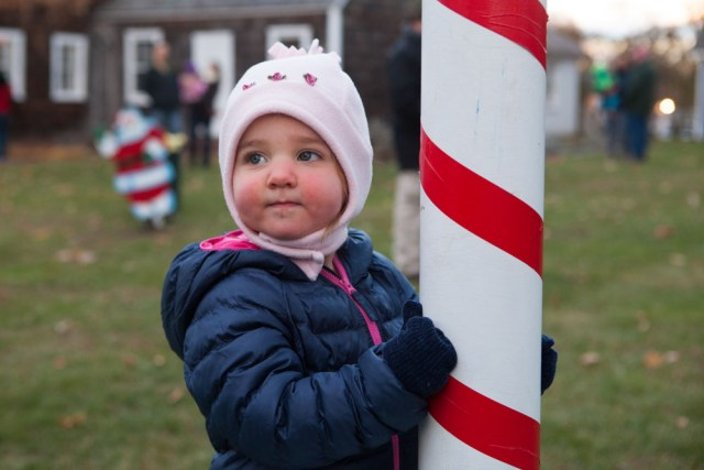 """Nineteen-month-old Maeve Flatley of Mattituck holds on tightly to the """"North Pole."""""""