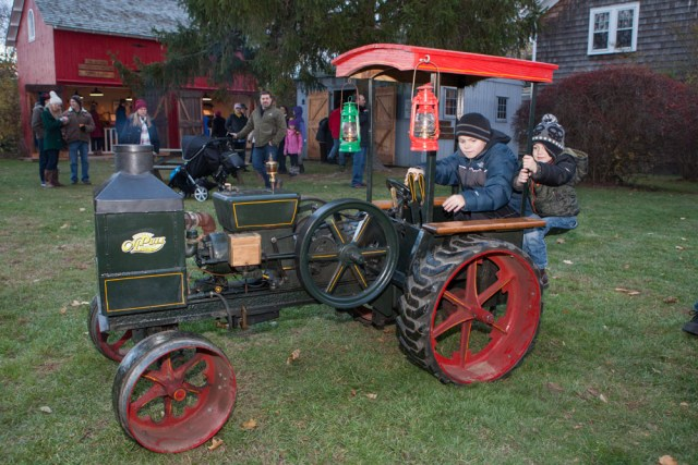 Matthew Goldberg, 9, and brother Daniel, 3,, of Merrick take a ride on a Christmas tractor.