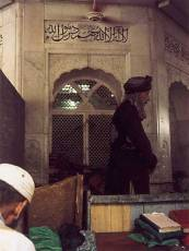 A dervish praying near the shrine of Data Ganj Bakhsh, Lahore