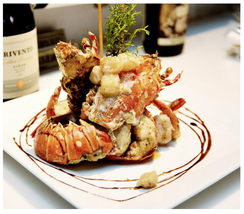 Fromage Brasserie's Signature Dish of Lobster, Shrimp & scallop tossed in white wine mornay sauce & stuffed in lobster tails.