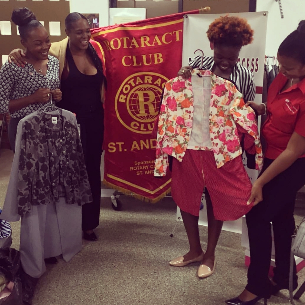 Members of the Rotaract Club of St. Andrew handing over their donation of Professional wear to Dress for Success Jamaica.