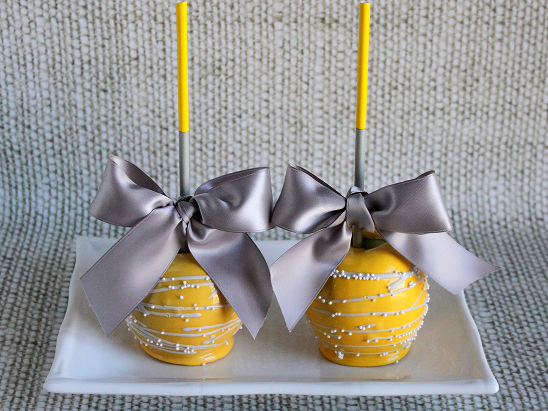 yellow wedding candy apples with gray bows