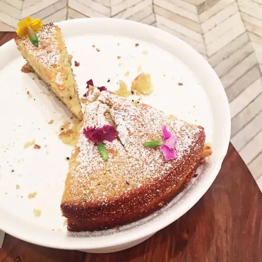 olive oil cake with edible flowers