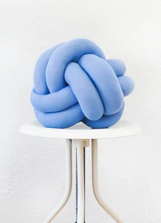 DIY knot pillow by Sugar & Cloth, an award winning DIY, recipes, and home decor blog.