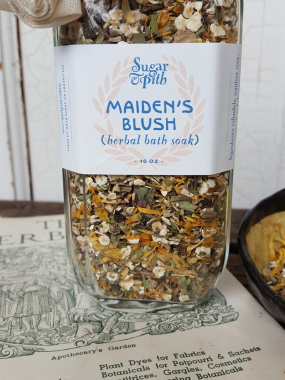 Sugar & Pith bottle of Maiden's Blush herbal bath soak close up of label