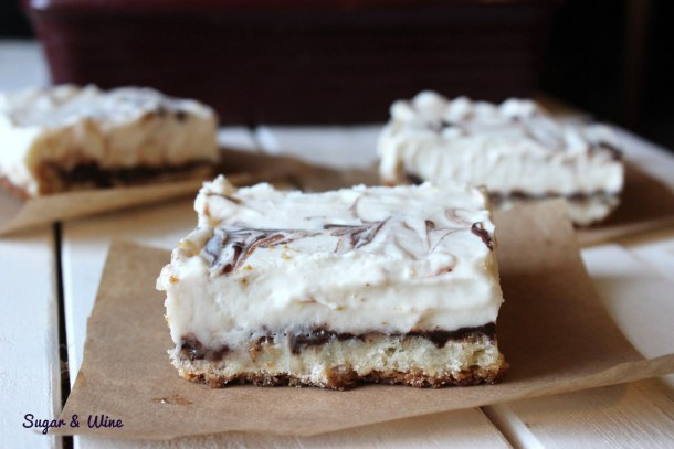 Vanilla and Chocolate Sugar Cookie Cheesecake Bars