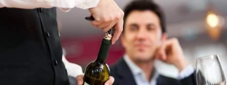 man choosing wine on first date