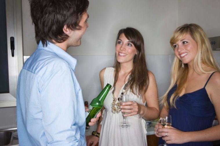 man making small talk to girls