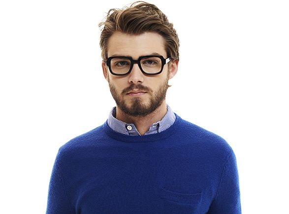 man with glasses wearing blue sweater