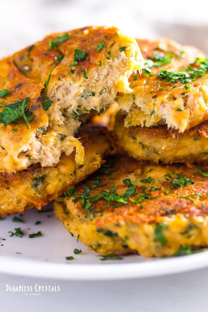 low carb salmon cakes with parsley with one split in half
