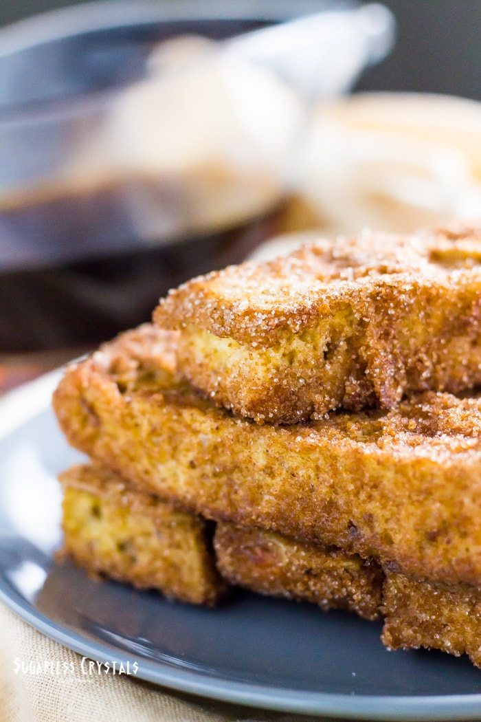 keto french toast sticks stacked with brown sugar and granulated monk fruit