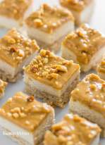keto cheesecake bites topped with peanut butter and peanut pieces