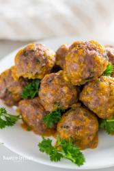 keto sausage balls on a plate with herbs