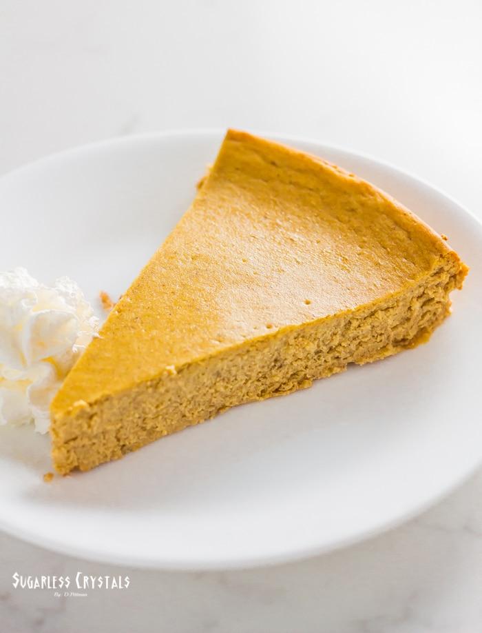 Pumpkin spice keto cheesecake on a plate sliced