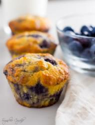 keto blueberry muffins lined with blueberries and milk
