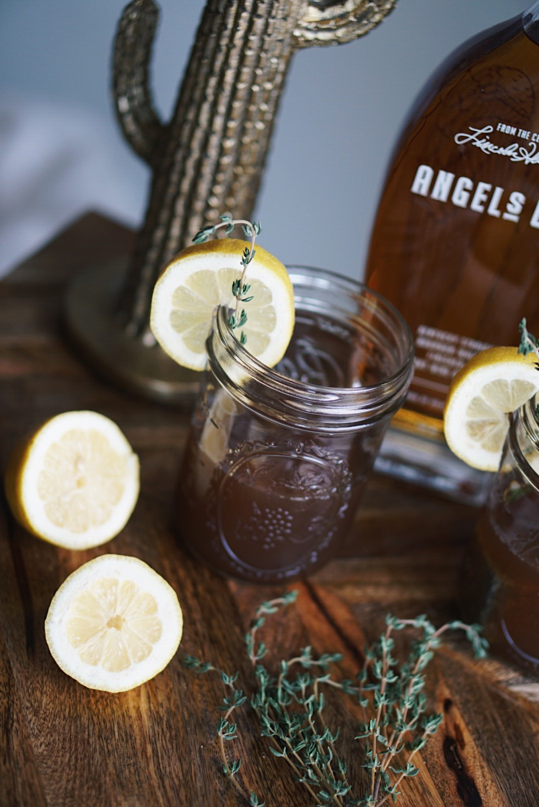 Sugar Love Chic Blogger Krista Perez shares a recipe for a Honey and Thyme Bourbon Cocktail perfect for St. Patrick's Day!