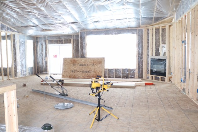 What to expect when building a new home // Ranch home interior being framed.