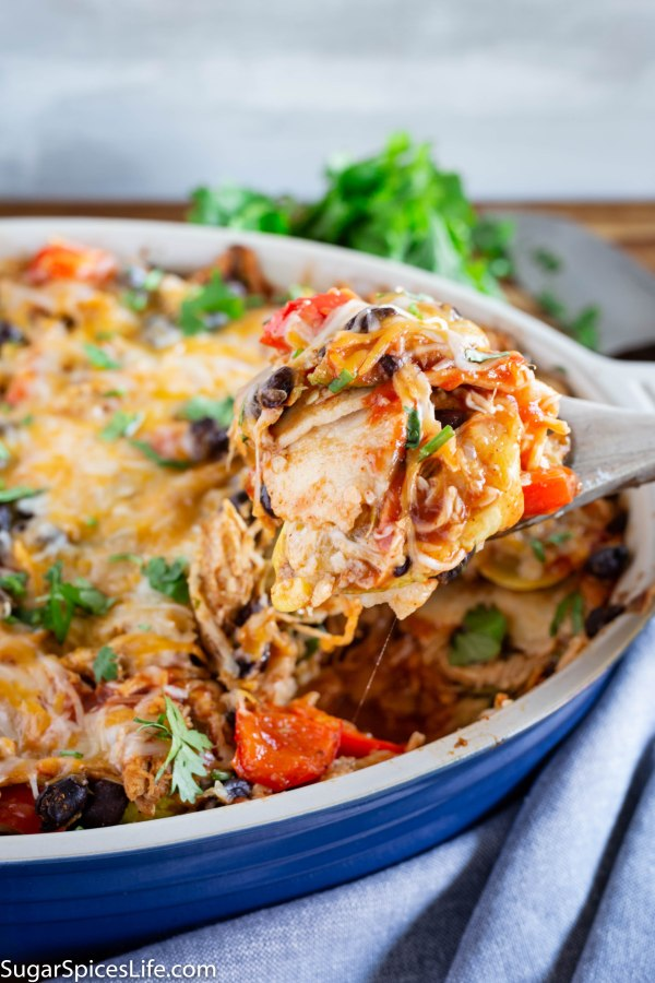 Chicken and Roasted Vegetable Enchilada Casserole. Layers of delicious roasted vegetables, chicken, enchilada sauce, cheese, and corn tortillas. An enchilada turned into a perfect casserole!