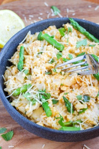 Lemon Chicken and Asparagus Risotto (Instant Pot or Stove Top). Creamy arborio rice with a hint of lemon, mixed with citrus herb chicken and asparagus, and topped with parmesan and parsley.