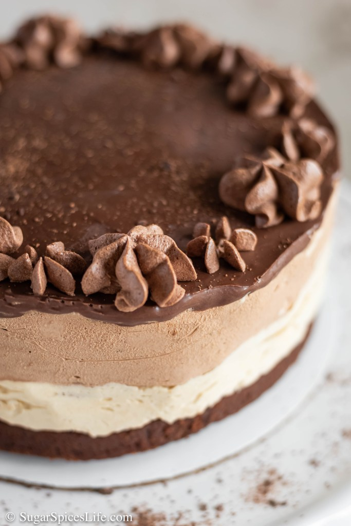 This Peanut Butter Chocolate Mousse Cake has a dense, chocolate cake bottom, followed by a peanut butter mousse layer, a chocolate mousse layer, and topped with chocolate ganache. It is rich, decadent, and all around amazing.