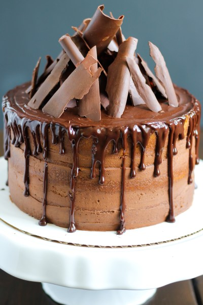 Vanilla Cake with Chocolate Buttercream. Delicious vanilla, yellow cake filled and frosted with chocolate buttercream, topped with chocolate ganache, and decorated with chocolate chards.