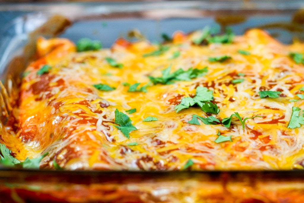 Chicken and Andouille Sausage Enchiladas. Mexican spiced chicken mixed with Andouille chicken sausage, wrapped in a tortilla, and topped with the best homemade enchilada sauce. These enchiladas take your at home Mexican nights to a whole new level.