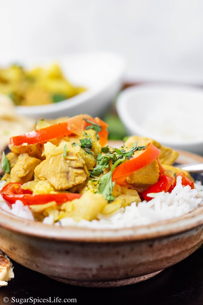 Lemongrass Curry Chicken. Chicken and vegetables cooked in a lemongrass curry sauce with coconut milk. Served with rice and naan. Savory, flavorful, and delicious.