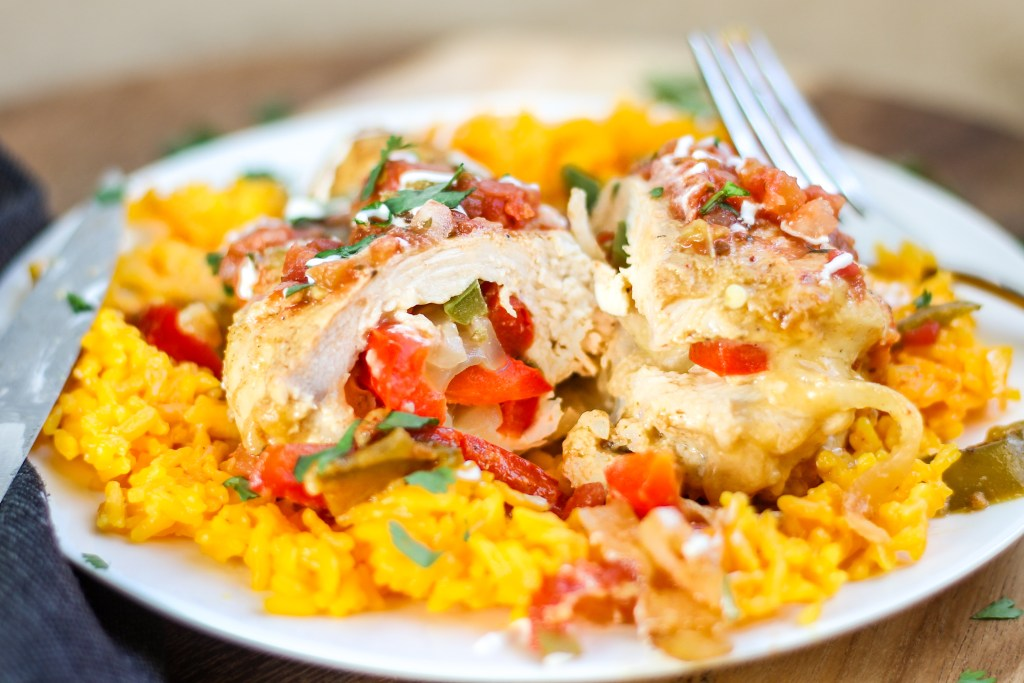 Fajita Stuffed Chicken. Chicken breasts cooked in a delicious sauce, stuffed with peppers, onions, and cheese, and served over yellow rice. You will want to lick the sauce out of the bottom of the pot.