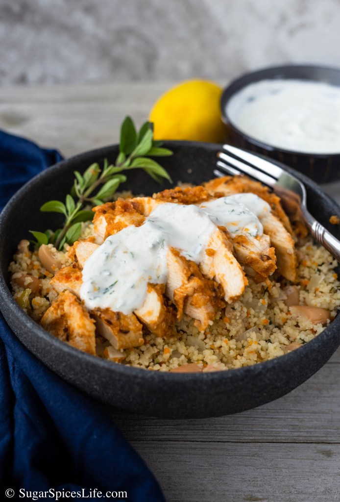 Harissa Chicken with Couscous and Mint Sauce. Chicken marinated in a homemade harissa sauce, served over a fresh herb couscous, and topped with a mint yogurt sauce. Full of delicious, unique flavor!