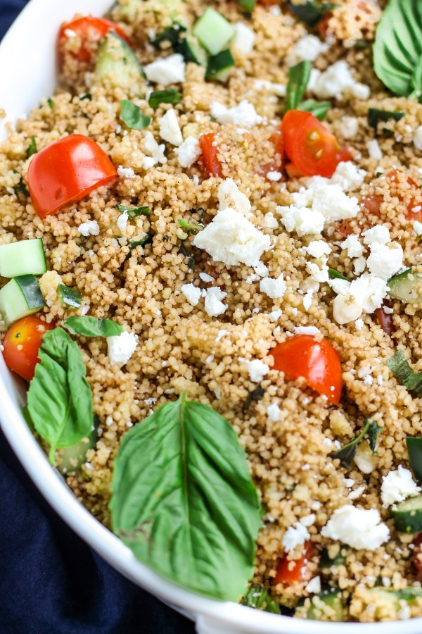 Fresh Herb and Vegetable Couscous Salad. Couscous tossed with fresh herbs, vegetables, and feta cheese, and finished with a balsamic dressing. Light and deliciously flavorful!