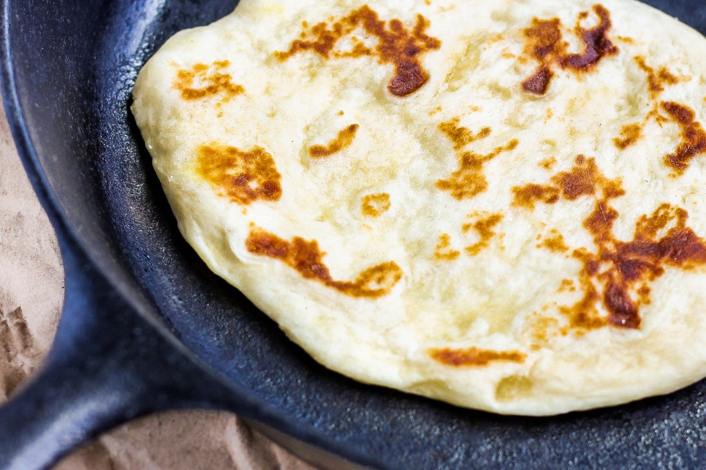 Homemade Skillet Naan. Irresistibly soft, delicious homemade naan. Quick and easy to make. It fills your house with a decadent smell and fills your belly with pure happiness.
