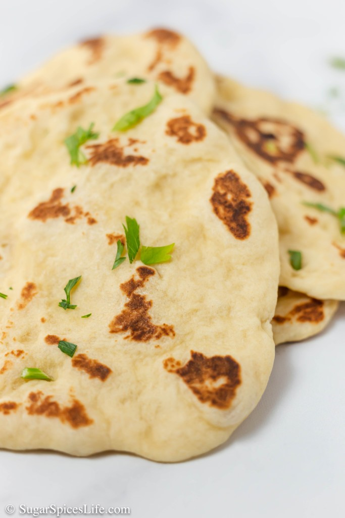 Homemade Skillet Naan. Irresistibly soft, delicious homemade naan. Quick and easy to make. Fills your house with a decadent smell and fills your belly with pure happiness.