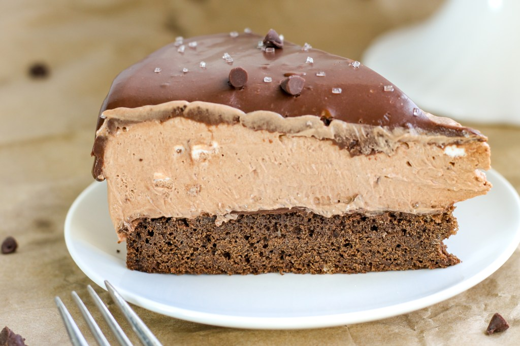 Nutella Mousse Cake. Fudgy chocolate cake base topped with a Nutella cream cheese mousse, followed by Nutella chocolate mousse, and topped with chocolate ganache. Decadently amazing. Pure heaven on a plate.