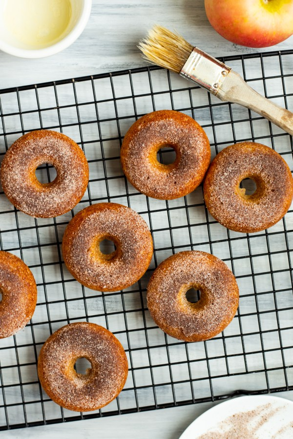 Apple Cider Donuts. Soft, baked donuts made with almond flour and reduced apple cider, finished with a sugar and fall spiced topping!