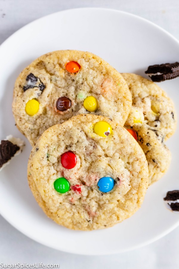 Chewy Oreo M&M Cookies. Chewy brown sugar cookies filled with bits of Oreo cookies and mini M&Ms. A perfect cookie for kids and adults alike!