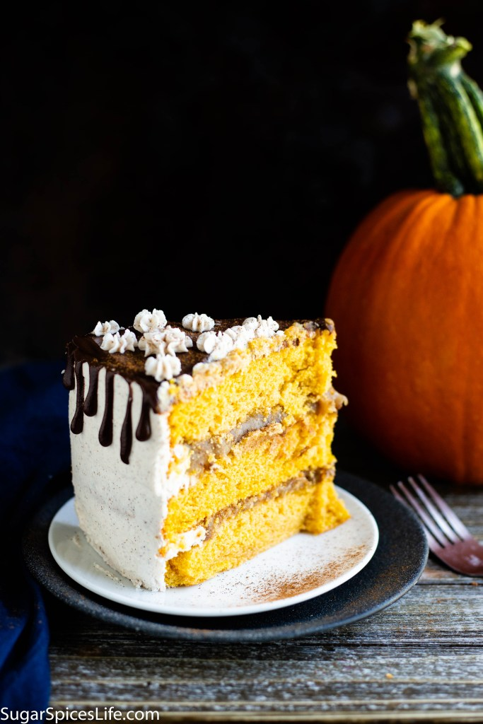 Pumpkin Churro Cake. Soft, cinnamon and pumpkin cake layers with a gooey praline filling, frosted with a pumpkin pie spiced white chocolate buttercream and finished chocolate ganache. All the amazing tastes of pumpkin and churros in a cake!