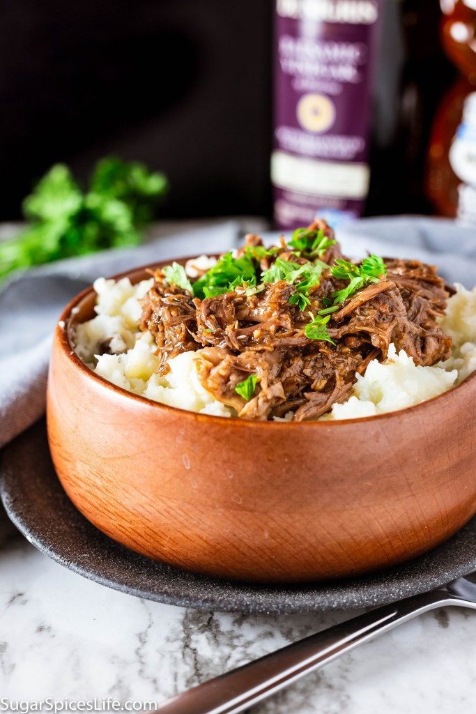 Honey Balsamic Beef with Buttermilk Mashed Potatoes (Instant Pot). Tender, shredded beef cooked in the Instant Pot, covered in a delicious honey balsamic sauce, and served over creamy buttermilk mashed potatoes.