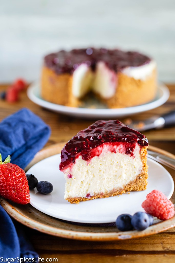 Instant Pot Cheesecake with Berry Topping. Decadent, creamy cheesecake topped with a delicious berry sauce. No baking required, just cook it in an Instant Pot!