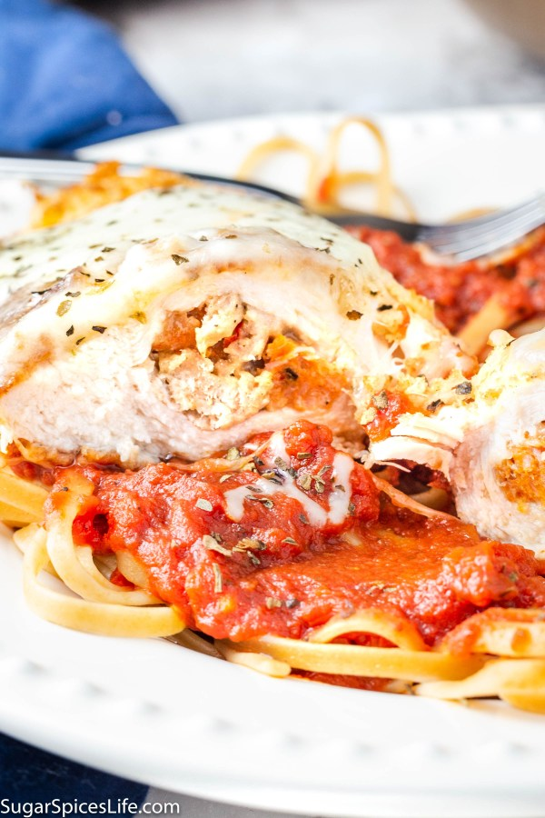 Stuffed Chicken Parmesan. Chicken breasts breaded with a delicious coating and stuffed with chicken sausage and mozzarella cheese. Served over linguine with a homemade tomato sauce.