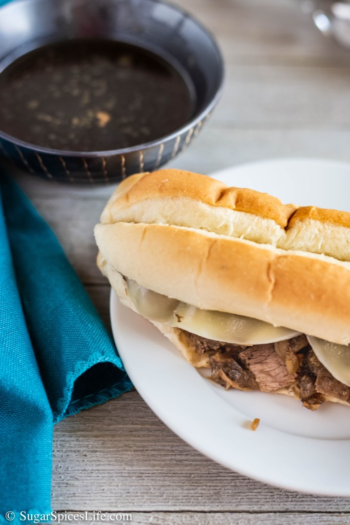 These Instant Pot French Dip Sandwiches are filled with tender beef, topped with provolone cheese, and dipped in a delicious au jus. Easy to make and great for lunch or dinner!