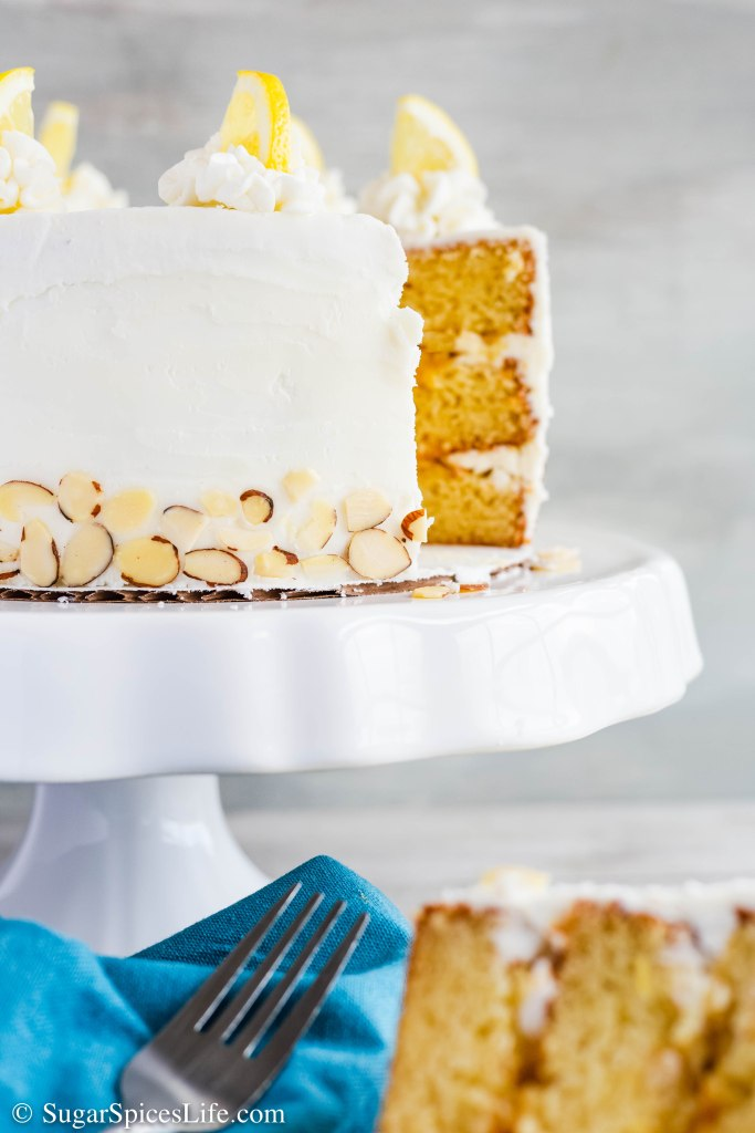 This Almond Lemon Cake has soft, almond cake layers, a tangy lemon curd filling, and white chocolate buttercream frosting. It's a delicious combination that is perfect for any event.