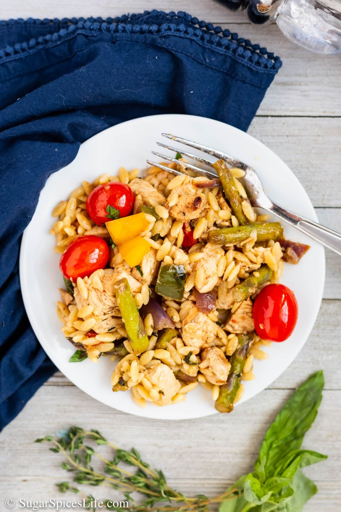 This Brown Butter Chicken and Vegetable Orzo has juicy chicken marinated in Greek dressing, sauted vegetables, and orzo that are tossed in a thyme brown butter sauce.
