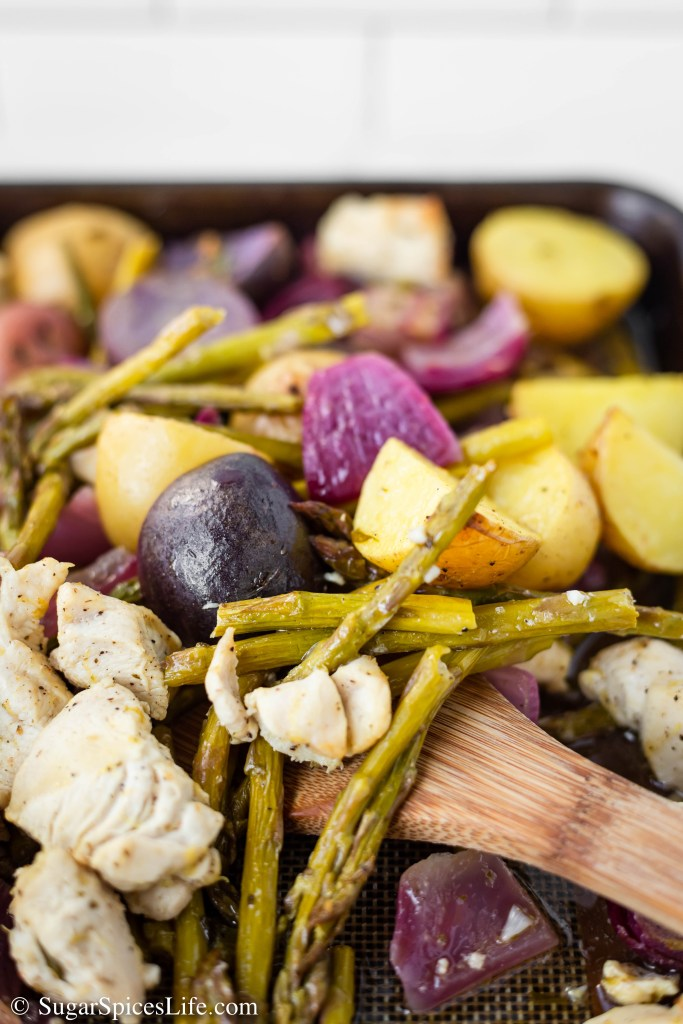 This Sheet Pan Lemon Chicken with Vegetables is quick and easy to throw together on a weeknight, but is full of flavor and will satisfy your family with just one dish!