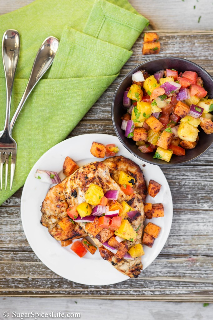 This African Chicken with Pineapple Salsa has chicken breasts marinated in a coconut milk Ras El Hanout spice sauce, grilled to perfection, and topped with pineapple and roasted sweet potato salsa. Quick, easy, and full of delicious flavor!