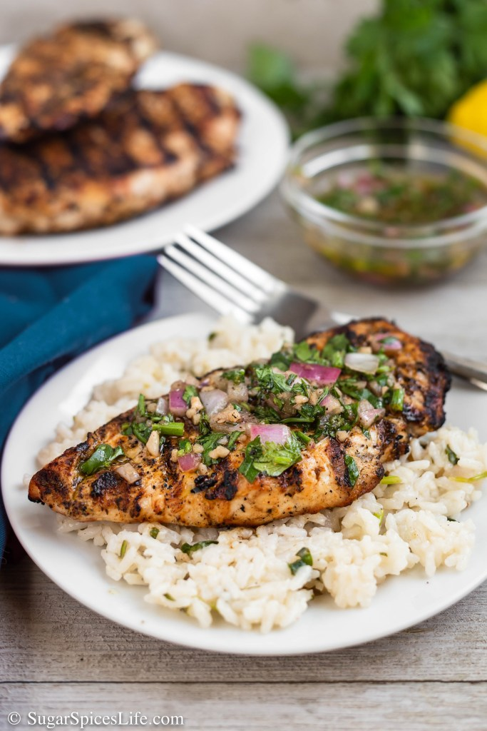 This Chimichurri Chicken and Rice has grilled chicken topped with a chimichurri sauce and served over a chimichurri flavored rice. It's an easy, delicious dinner that is full of flavor.