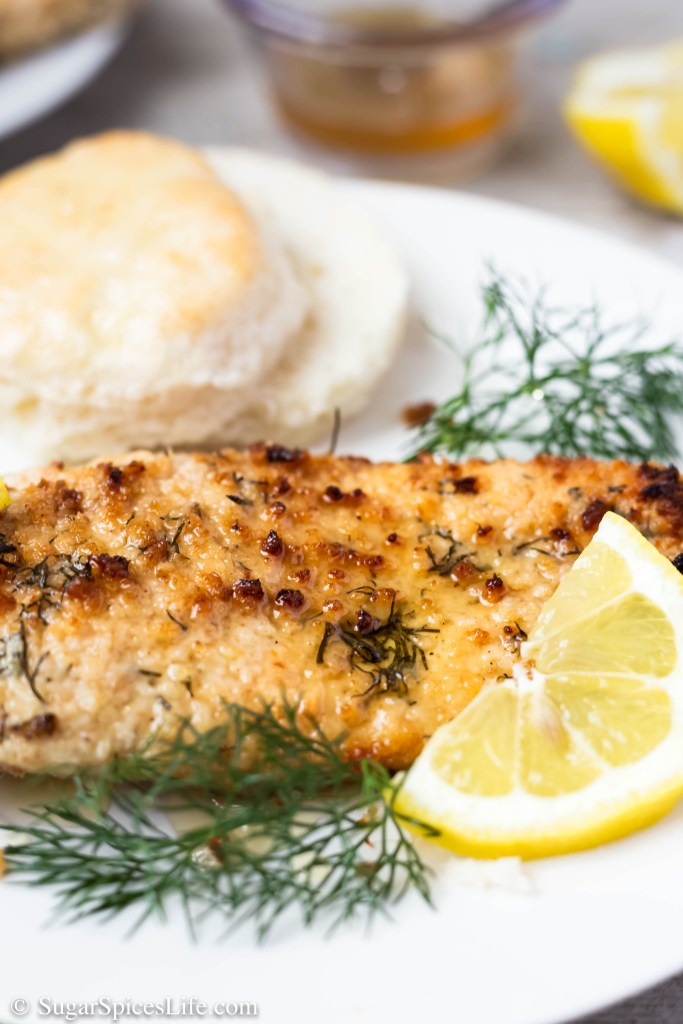 This Lemon Dill Fried Chicken recipe has chicken breasts marinated in buttermilk, coated with a dill seasoned breadcrumb, fried in an air fryer or oven, and served with a lemon-honey sauce. It's a quick and easy dish that is full of flavor.