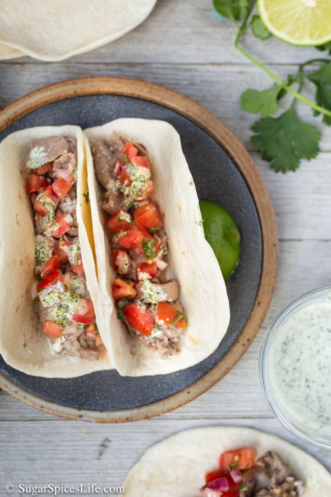 Juicy, garlic flavored beef tacos topped with a fresh tomato salsa and cilantro lime sauce. These Garlic Beef Tacos are an easy, flavorful weeknight meal!