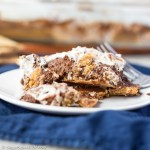 Graham cracker crust topped with a chocolate ice cream pudding and finished with marshmallow spread. This S'mores Refrigerator Dessert is sure to be a hit!
