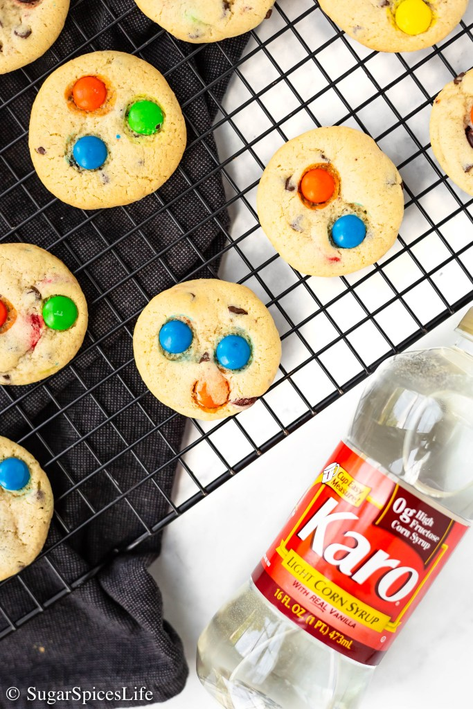 Soft, chewy cookies filled with mini chocolate chips and candy coated chocolate pieces. These Chewy Chocolate Chip Candy Cookies are easy to make and addictively delicious! #BakeBetterCookies #CollectiveBias #ChewyCookies #ad